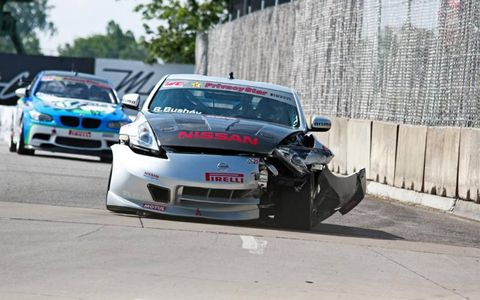 The injured Nissan Nismo 370Z of Ric Bushey makes its way around the Detroit Belle Isle circuit before qualifying on Saturday.