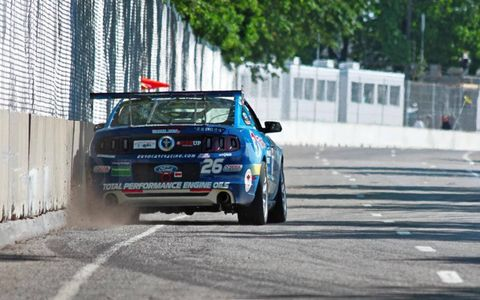 The No. 26 Ford Mustang Boss 302S driven by Aaron Povoledo kicks up some dust during qualifying on Saturday.