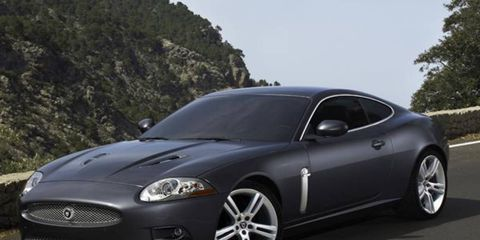 """The supercharged 4.2-liter V8 under the XKR's hood features twin air intakes and continuously variable valve timing—mated to what Jag claims is a """"class-leading"""" six-speed automatic paddle-shift transmission—and cranks out 120 more horses than the normally aspirated version driving the standard XK, with an added 113 lb-ft of torque on tap. Jaguar claims it's enough power to help propel the XKR coupe from 0 to 60 mph in only 4.9 seconds, just slightly longer (5.0 seconds) for the convertible."""