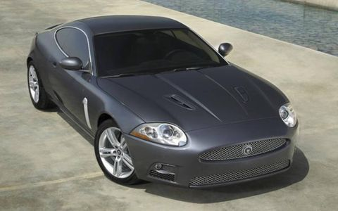 "The supercharged 4.2-liter V8 under the XKR's hood features twin air intakes and continuously variable valve timing—mated to what Jag claims is a ""class-leading"" six-speed automatic paddle-shift transmission—and cranks out 120 more horses than the normally aspirated version driving the standard XK, with an added 113 lb-ft of torque on tap. Jaguar claims it's enough power to help propel the XKR coupe from 0 to 60 mph in only 4.9 seconds, just slightly longer (5.0 seconds) for the convertible."