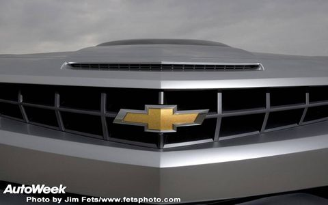 Motor vehicle, Automotive design, Automotive exterior, Grille, Hood, Emblem, Logo, Symbol, Black, Bumper,