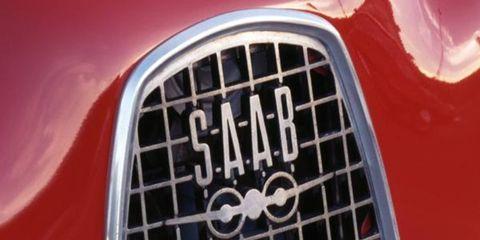Motor vehicle, Grille, Automotive exterior, Red, Automotive lighting, Classic car, Hood, Symbol, Radiator, Kit car,