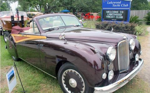 "Don Poinsette's 1955 Jaguar Mark VII Convertible towed the ""Curio"" Chris Craft boat."