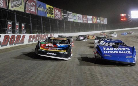 Kyle Busch, left, and Kasey Kahne lead the field at the Prelude to the Dream event at Eldora, Ohio.