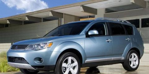 """When it arrives in showrooms in October, customers will see a 2007 Outlander that is more practical, more powerful and ready to perform both mouth-to-mouth and CPR on Mitsubishi Motor Sales America. The Outlander has almost two inches more wheelbase, which allows for the class-requisite third-row seats. Granted, these third-row seats are perhaps the flimsiest in production, more like a pair of third-row folding beach chairs, but they qualify. More versatility comes from the """"flap-fold"""" two-piece tailgate located behind that third row that allows still more flexibility for storage."""