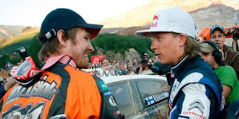 Kimi Raikkonen congratulates Taddy Blazusiak at the Red Bull Hare Scramble.