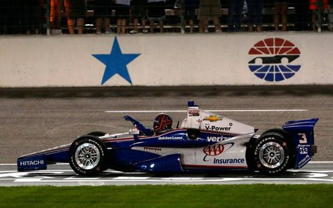 Race winner Helio Castroneves runs out of fuel after crossing the finish line in Texas on Saturday night.