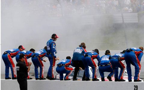 Dale Earnhardt Jr.'s crew celebrates on the pit wall at Pocono on Sunday.