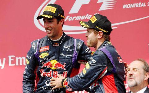 Daniel Ricciardo and teammate Sebastian Vettel, right, celebrate on the podium in Montreal after Ricciardo finished first and Vettel third on Sunday.