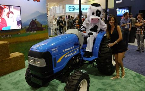 The cow always gets the girl, in this case, the Farming Simulator 15 cow poses with a farmhand.