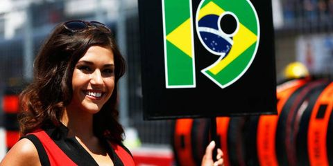 Grid girls in Montreal played a key role in getting drivers to their cars before the Formula One race.