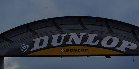Automotive tire, Automotive exterior, Logo, Plain, Sport utility vehicle, Advertising, Van, Synthetic rubber, Field, Kit car,