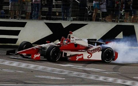 Justin Wilson celebrates his first IndyCar Series win with a burnout.