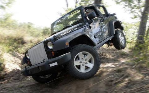 Only the most die-hard Jeep geeks will have an easy time distinguishing the 2007 Wrangler from the TJ. The major Wrangler cues have been left essentially untouched: industrial-looking exposed hinges, seven-slat grille, removable doors and windshield, round headlights, etc. But a closer look reveals the differences. Gone is the 4.0-liter straight-six familiar to scads of Wrangler lovers. In the JK, power shuttles through a six-speed manual transmission from a 3.8-liter overhead valve V6 engine, with 205 hp and 240 lb-ft of torque. A four-speed automatic is also available.