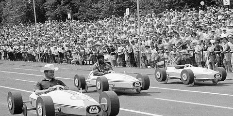 Bobby Unser (in cowboy hat) drove a lot of different cars to victory circle during his illustrious career, including one that didn't have an engine. In a celbrity event before the 34th running of the All-American Soap Box Derby in Akron, Ohio, in August 1971, Unser won the Oil Can Trophy Race by beating basketball start Oscar Robertson of the Milwaukee Bucks and actor Jim Backus. The hat, no doubt, added to Unser's aerodynamic edge.