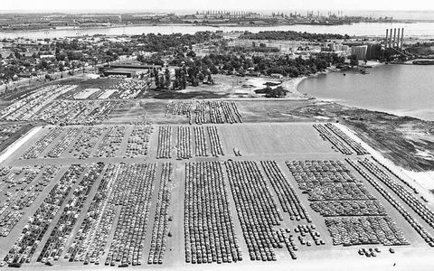 The Dundalk Marine Terminal in Baltimore Harbor, Maryland is jammed Aug. 17, 1971, with imported cars coming into the country at a rate of more than 1000 each day. Dundalk Marine Terminal was the nation's largest port of entry for foreign cars. In the background, Bethlehem Steel Corporation's Sparrow Point plant stands idle as a result of a lack of orders for steel.