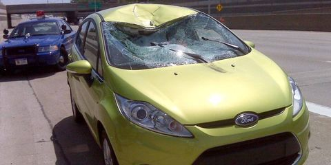 the aftermath of a wheel crashing into the ford fiesta