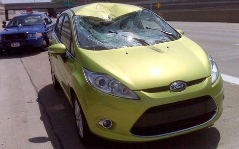 The aftermath of a wheel crashing into the Ford Fiesta.