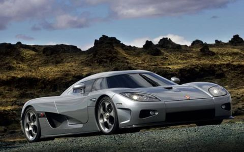 If you want to go by sheer speed, the Koenigsegg CCR is officially the fastest production car in the world, having lapped Italy's Nardo test track at 241 mph last year, about 1 mph faster than the McLaren F1. Keep in mind that Nardo is just a big, round circle, meaning the front wheels were slightly turned the whole time and keeping it from hitting an even higher top speed. Find a place where you can straighten the wheels and the number will be even higher. Maybe they need to take one of these to the Bonneville flats.