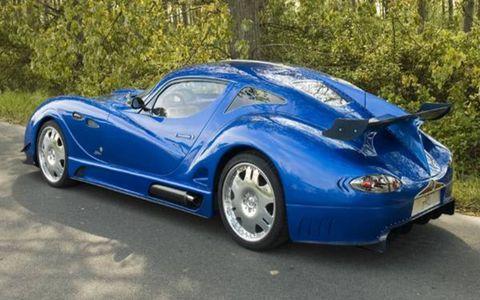 Tire, Wheel, Mode of transport, Automotive design, Blue, Vehicle, Rim, Automotive tire, Car, Alloy wheel,