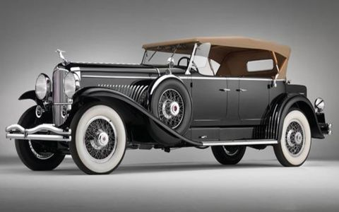 A 1931 Duesenberg Model J Tourster owned by a long line of recognizable figures including comedian Joe E. Brown and business magnate Howard Hughes sold for $1,485,000.