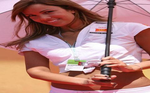 A grid girl shares a playful exchange of glances with the camera.