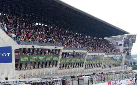 Sport venue, People, Product, Crowd, Stadium, Fan, Sports, Logo, Audience, Race track,