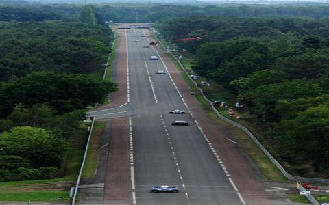 Motor vehicle, Road, Mode of transport, Transport, Road surface, Infrastructure, Lane, Highway, Asphalt, Tree,