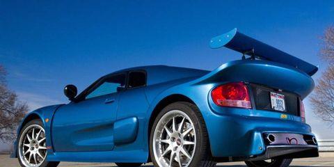 Tire, Wheel, Automotive design, Blue, Vehicle, Automotive tail & brake light, Alloy wheel, Land vehicle, Automotive exterior, Rim,