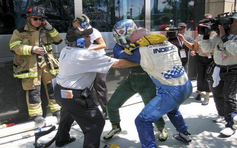 """Champ Car heavyweights Alex Tagliani and Paul Tracy spiced up the San Jose race by taking a page from the book of fellow Canadian and professional wrestler Bret """"The Hitman"""" Hart."""