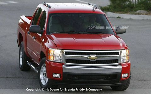Our spies caught this camera-ready 2007 Chevrolet Silverado as it sprinted out of a car carrier and ran through a carwash in preparation for a television commercial shoot. Shown here in Crew Cab configuration with the Z71 off-road package and wearing brochure-red paint is Chevy's next-gen pickup.