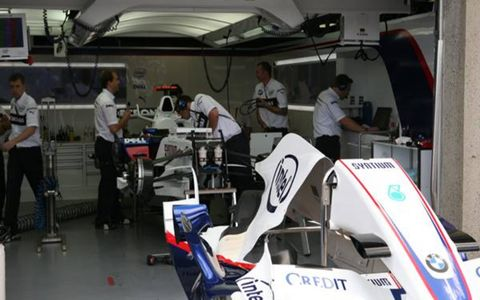 The BMW-Sauber F1 readies Nick Heidfeld's car for the race.