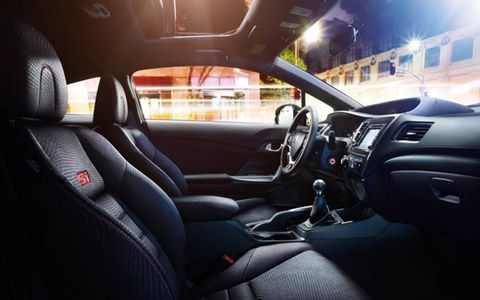 The 2013 Honda Civic Si Coupe is equipped with a 2.4-liter I4 mated with a six-speed manual.