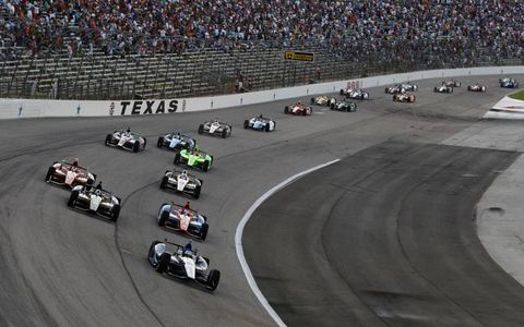 2012 IndyCar Texas: Pole sitter Alex Tagliani leads the field through turn one at the start.