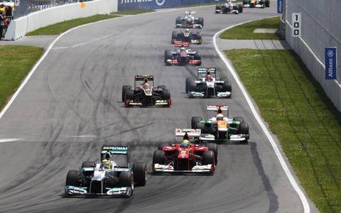 2012 Canadian Grand Prix: Nico Rosberg, Mercedes F1 W03, leads Felipe Massa, Ferrari F2012, Paul di Resta, Force India VJM05 Mercedes, Romain Grosjean, Lotus E20 Renault, and Michael Schumacher, Mercedes F1 W03.