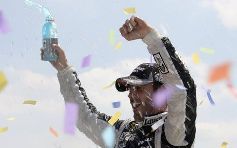 Jimmie Johnson celebrates after winning at Michigan.