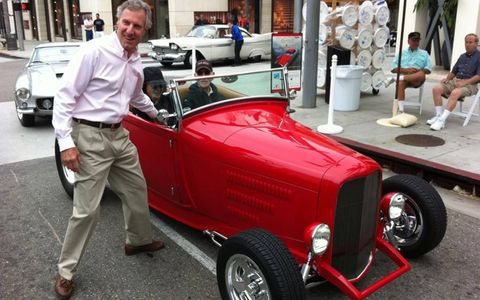 Organizer Bruce Meyer welcomes Ed Pink and his roadster to teh show.
