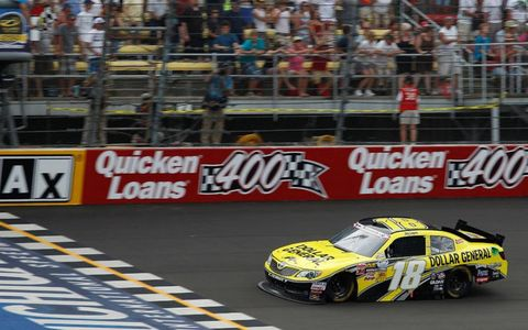 Joey Logano takes the checkers at Michigan.