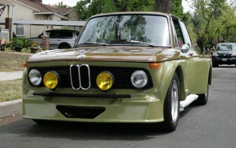 The interior and fiberglass work on the 1969 BMW 2002 is custom.