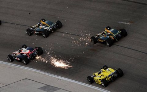 SPARKS FLY//Will Power (No. 12) passes Takuma Sato (No. 5) in a shower of sparks at the Texas Motor Speedway. Power won the second race of the twin bill, with Dario Franchitti visiting the winner's circle after the first race.