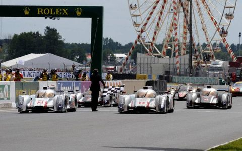 Audi crosses the line with a 1-2-3 finish at Le Mans on Sunday.