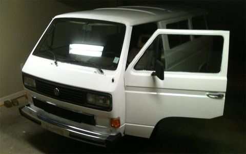 The van, painted white. No word on whether it was done so with a brush.