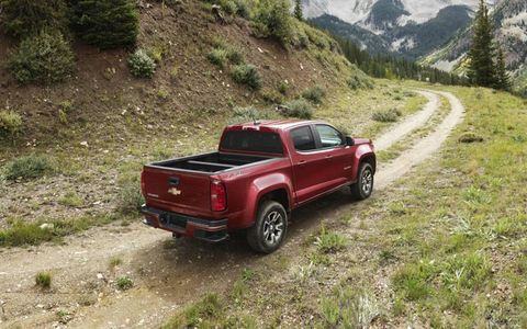 The 2015 Chevy Colorado gets the choice of a 2.5-liter four making 200 hp or a 3.6-liter V6 making 305 hp.