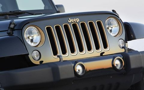 Bronze accents on the grill of the 2014 Jeep Wrangler Unlimited Dragon Edition offer a more flashy presentation.