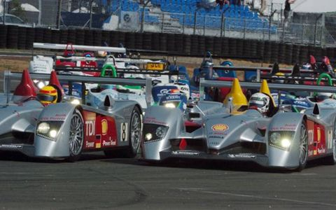 Audis lead the first lap.