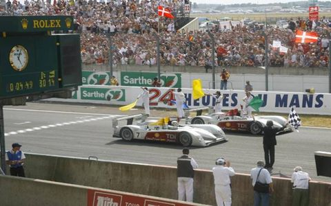 The race-winning No. 8 Audi crosses with the No. 7 Audi, which finished third.