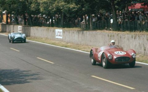 Georges Guyot leads an Aston Martin in his Maserati 200S.
