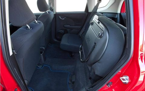 The bottom cushion of the rear seat flips up for hauling tall cargo