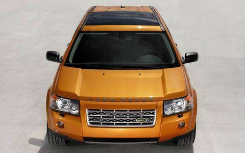 Motor vehicle, Mode of transport, Automotive design, Automotive exterior, Transport, Product, Yellow, Automotive lighting, Automotive mirror, Vehicle,