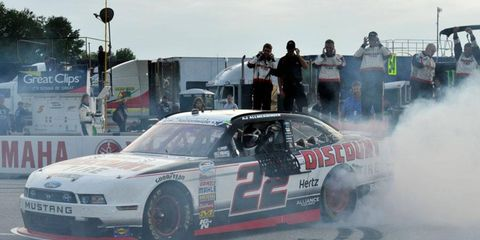 A.J. Allmendinger celebrates his first NASCAR win on Saturday night.